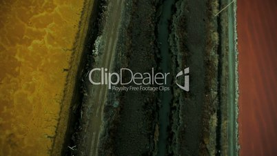 Aerial view of rich coloured natural salt evaporation ponds