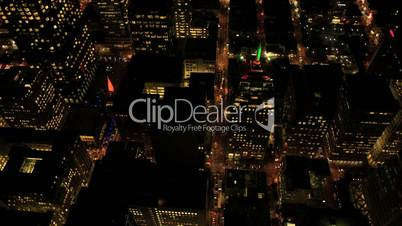 Aerial night vertical view of skyscrapers in a modern urban city, USA