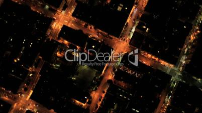 Aerial night vertical view of rolling roads city traffic, USA