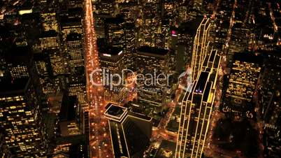Aerial night view of skyscrapers and streets, Metropolis, USA