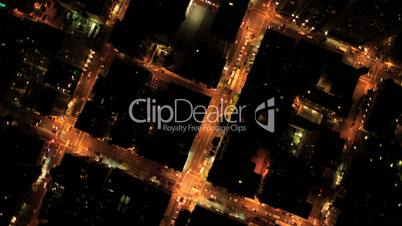 Aerial vertical view at night of city traffic, streets and skyscrapers, USA