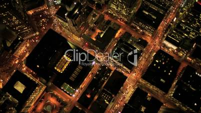 Aerial night vertical view of skyscraper rooftops, USA