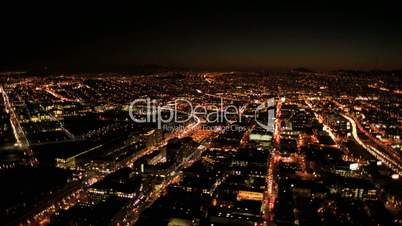 Aerial night illuminated cityscape view of rolling city streets, San Francisco, USA