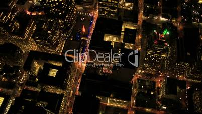 Aerial night  illuminated vertical view of rolling roads city traffic, USA