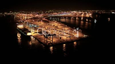 Aerial night view of the Port of Oakland, San Francisco Bay, USA