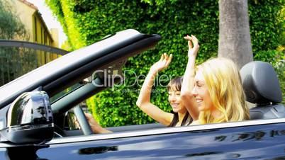 Beautiful Girls Driving a Convertible