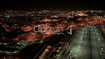 Aerial night view of the illuminated  Port of Oakland, San Francisco, USA