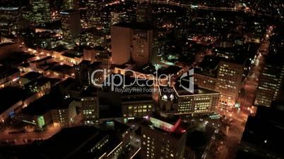 Aerial night illuminated view of city blocks and streets, America