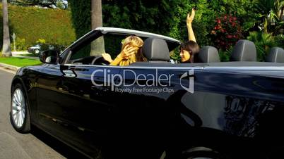 Laughing Girls Driving on Vacation