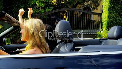 Girls Having Fun in Luxury Cabriolet