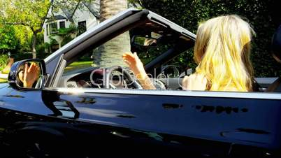 Girls Singing Laughing in Luxury Convertible
