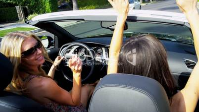 Girlfriends on Vacation Driving Open Top Car