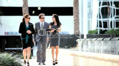 Business Colleagues Walking to Meeting