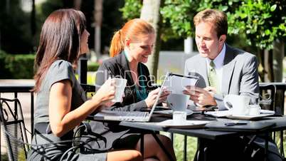 Business People Using Laptop Outdoor CafŽ