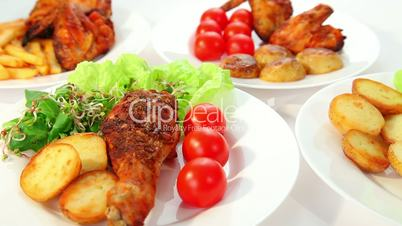 Roasted chicken with potatos chips salad and tomatoes dolly shot