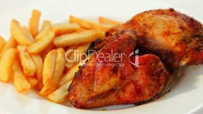 Roasted chicken wings and chips dolly shot