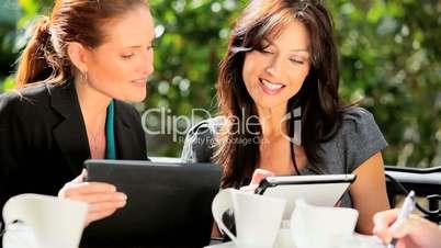 Businesswomen Using Wireless Tools Downtown CafŽ