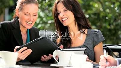 Female Management Team Good News via Tablet
