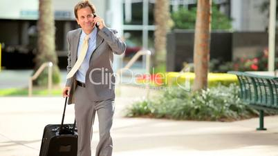 Businessman on Smart Phone with Travel Luggage