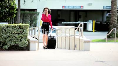 Businesswoman with Smart Phone and Travel Luggage