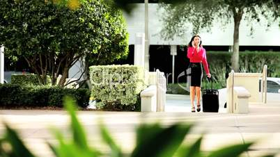 Businesswoman with Smart Phone Returning from Travel