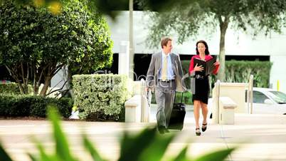 Businesswoman Walking with Traveling Colleague