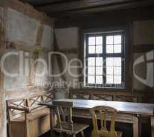 rustic chamber with bench, table and chair.