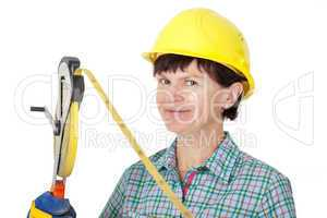 Construction worker with a tape measure