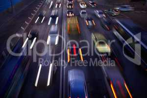 Car traffic at night. Motion blurred background.