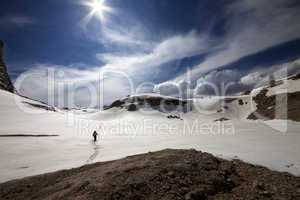 Hiker on snow plateau