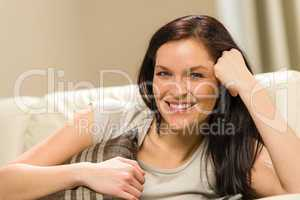 Young smiling woman relaxing at home