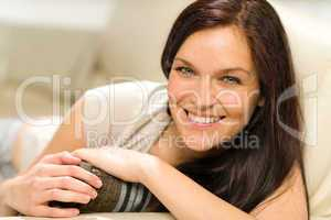 Serene cheerful woman lying on couch