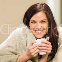 Portrait of joyful woman drinking hot beverage