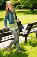 Young smiling girl relaxing in the park
