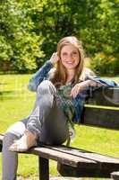 Adolescent girl enjoy sun outside in park