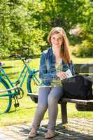 Teenager student girl sitting on bench