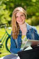 Student girl studying with tablet outside