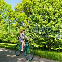 Happy woman riding fast her bike