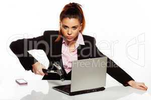 businesswoman fixing her laptop with a hammer