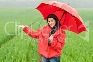 Elated smiling girl during rainy weather