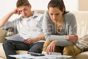 Annoyed couple calculating their finances