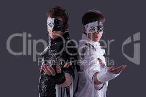 Portrait of attractive young guys in masks