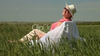 Joyful Senior Lady Relaxing On The Nature