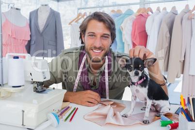 Fashion designer petting his chihuahua