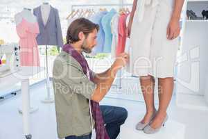 Fashion designer picking needles
