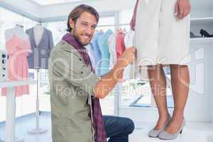 Fashion designer sitting next to a model
