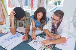 Three fashion designers working together