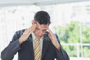 Businessman rubbing his temples