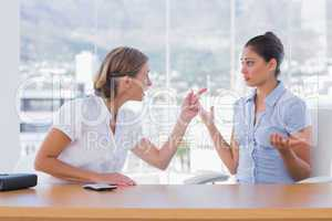 Businesswomen arguing together
