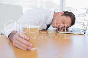 Asleep businessman on his laptop